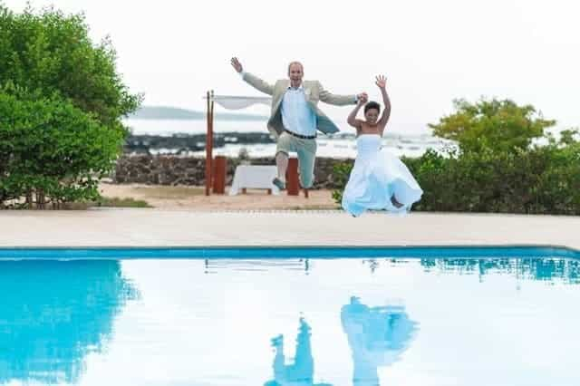 Bride and Groom Jumping In Swimming Pool