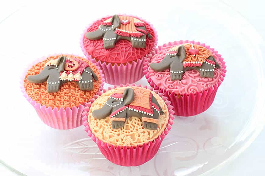 Bespoke Asian elephant wedding cupcakes in pinks and oranges