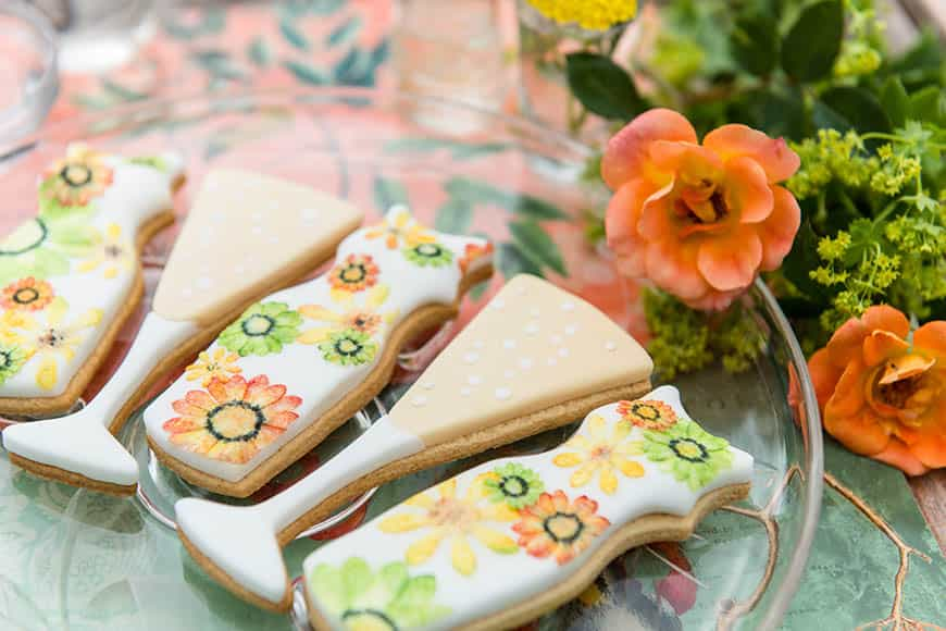 Champagne and floral dresses for a summer wedding handcrafted luxury biscuit favours
