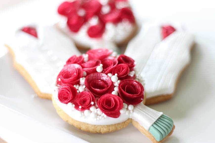 Red and white wedding posy and waistecoat cookie favours